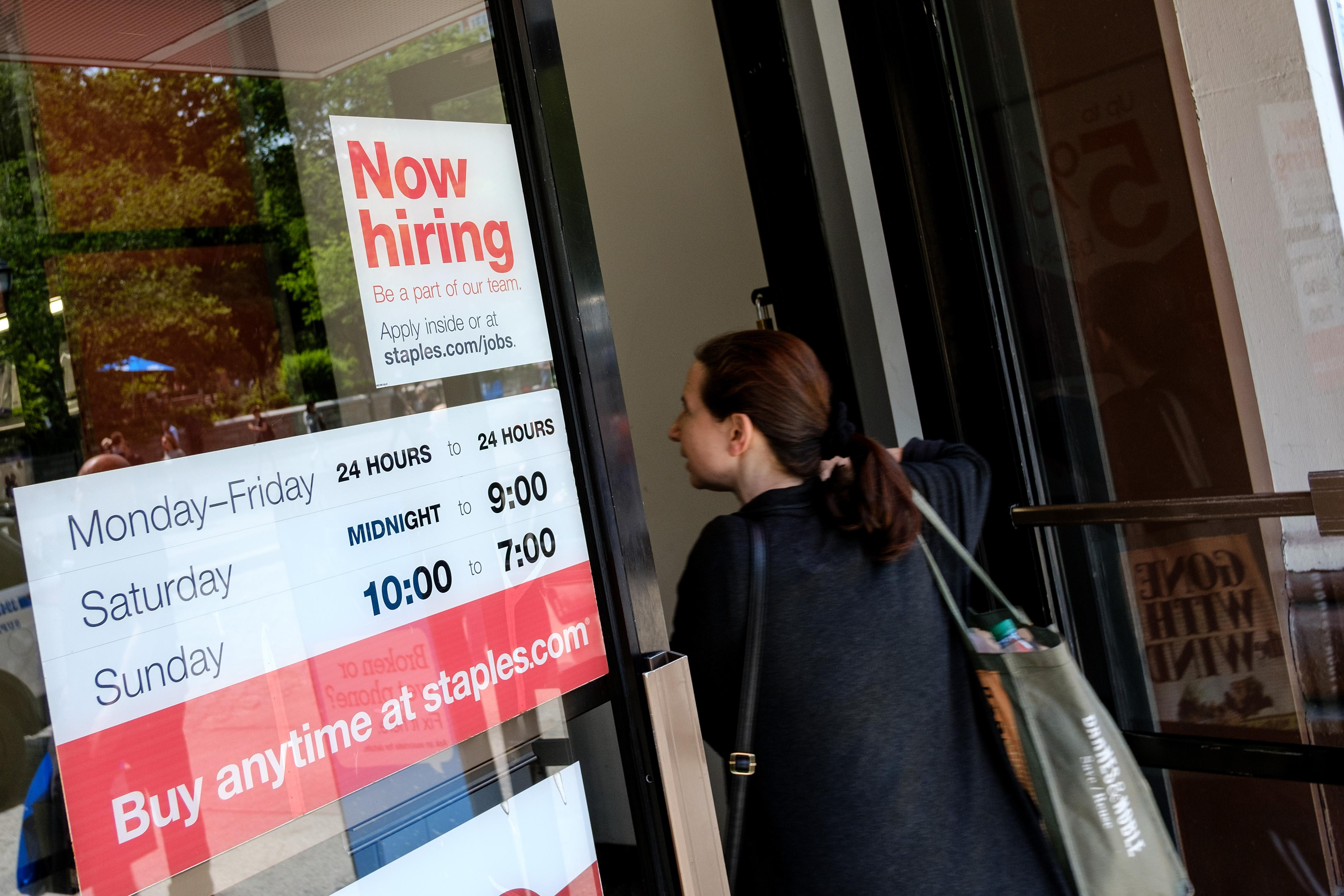 NEW YORK, NY - JUNE 2: A 'now hiring' sign is displayed on the front entrance to a Staples store,  June 2, 2017 in New York City. While U.S. unemployment has hit it lowest level since 2001 at 4.3 percent for May, the U.S. economy added only 138,000 jobs last month and many Americans have stopped looking for work. (Photo by Drew Angerer/Getty Images)