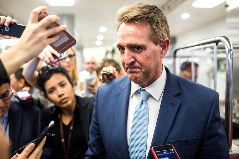 Sen. Jeff Flake (R-AZ) speaks to reporters following a vote on Capitol Hill on January 11, 2018 in Washington, DC.