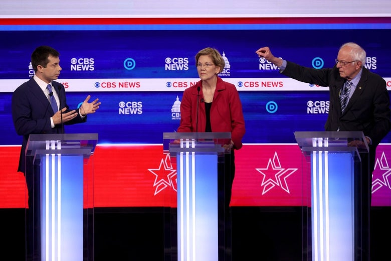 Buttigieg and Sanders gesture at each other from their lecterns as Warren stands between them.