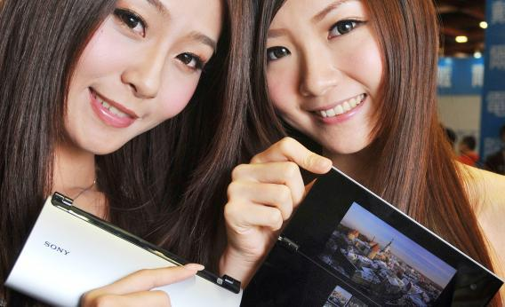 Two models show Sony's new Tablet P
