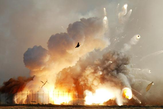 The rocket that carried the next generation supersonic model aircraft explodes on impact after it crashed into the desert at the Woomera rocket range in outback Australia.