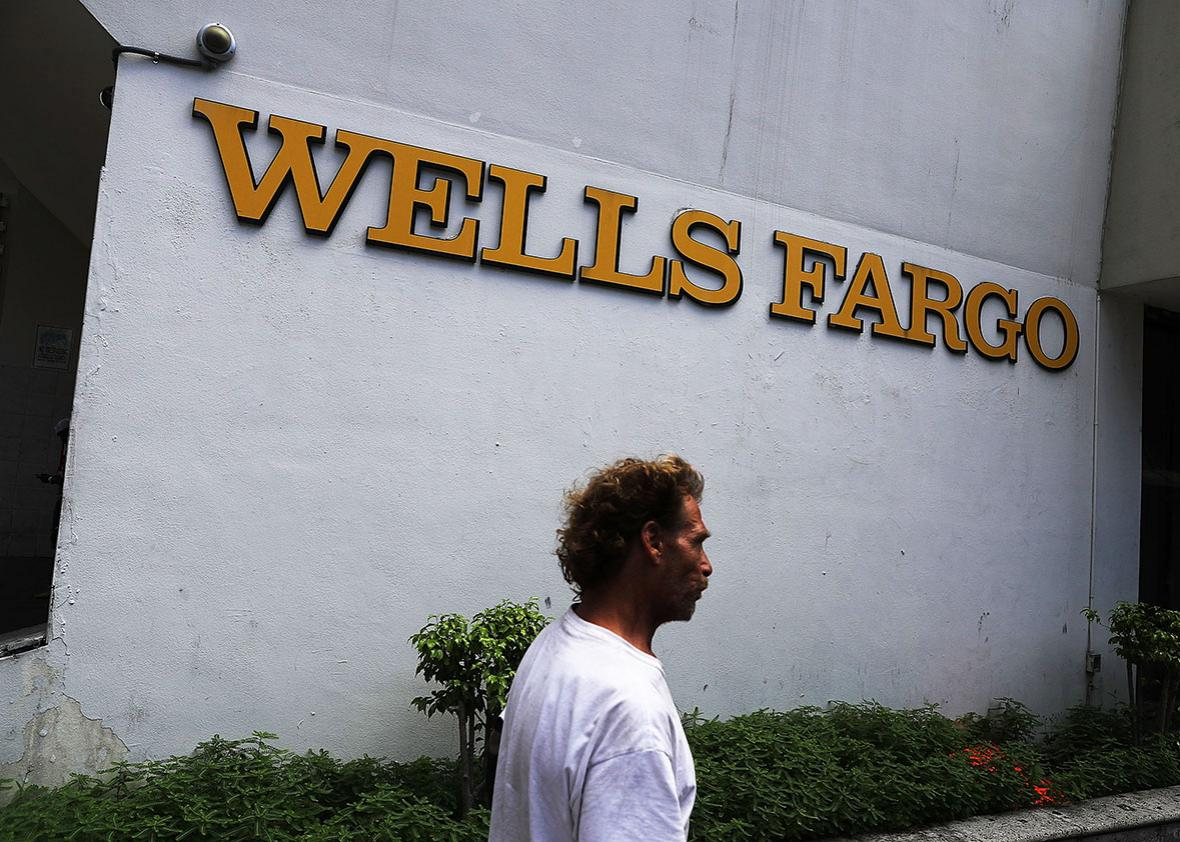 A Wells Fargo sign is seen on the exterior of one of their bank branches on September 9, 2016 in Miami, Florida.