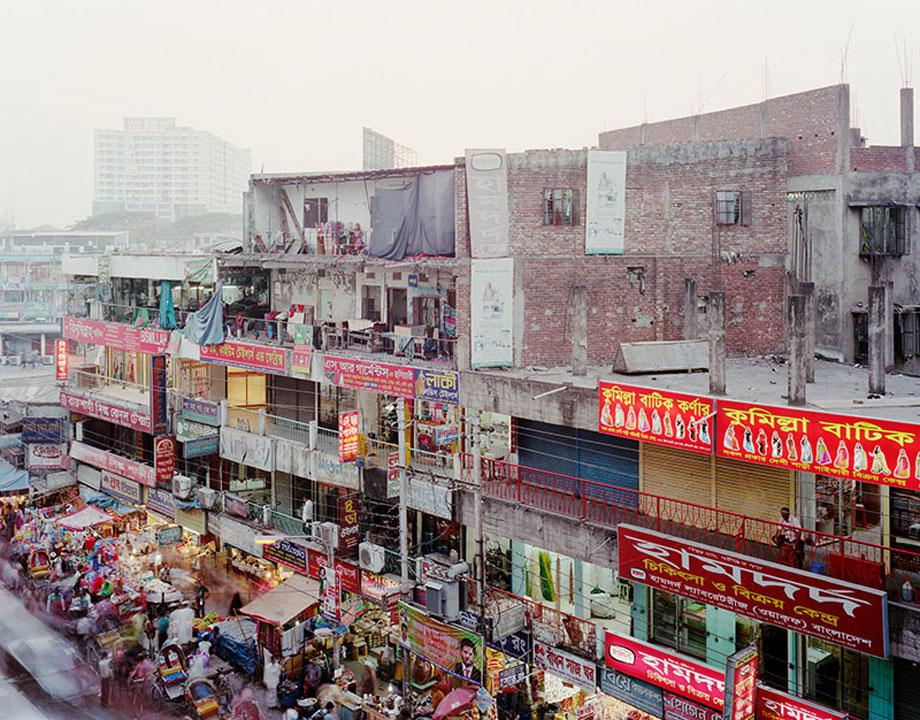 View of homes and businesses in the New Market area of Dhaka, Bangladesh in February, 2013. The area is home to a large street market as well as other shops, small factories and other businesses.