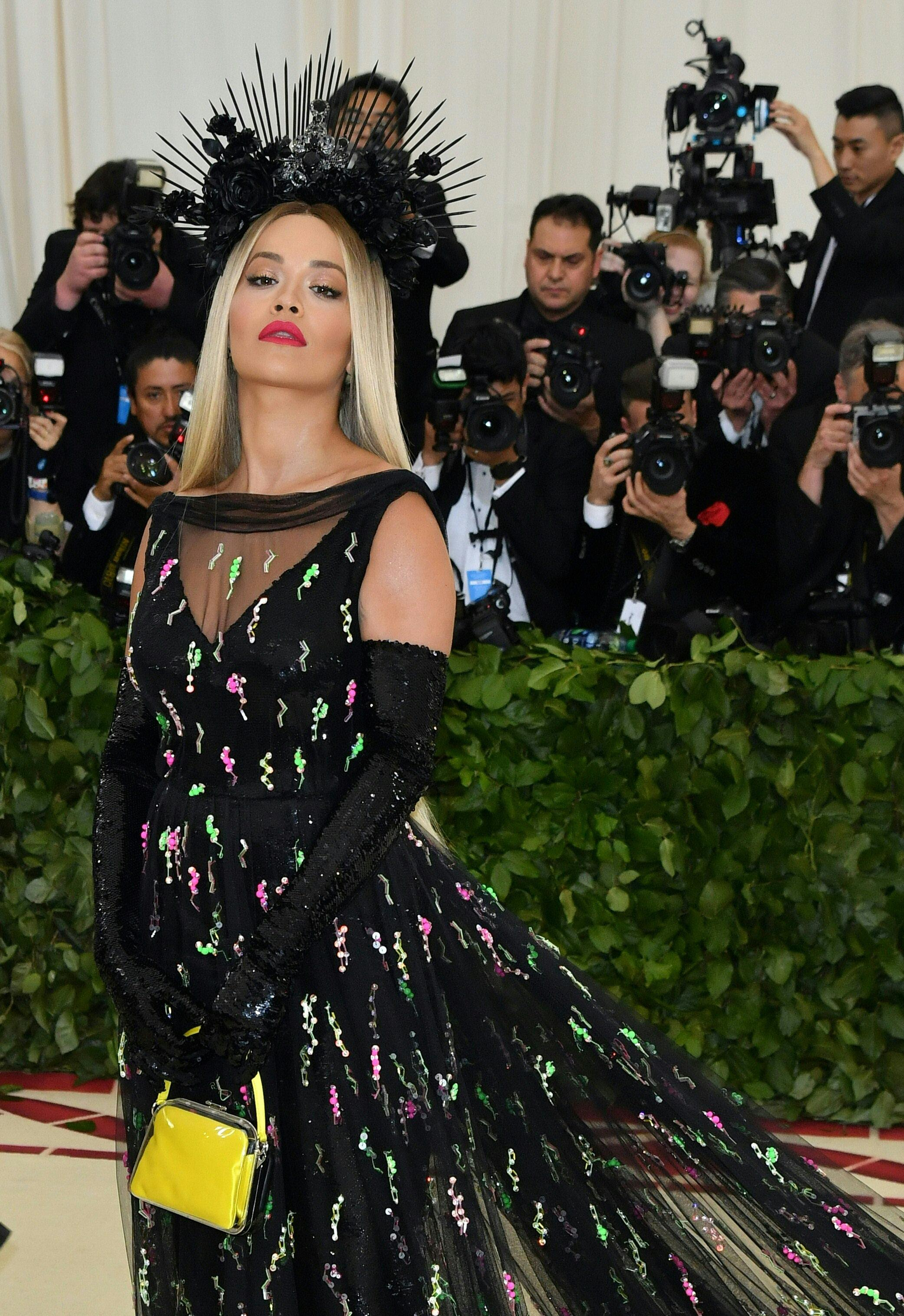 Rita Ora arrives for the 2018 Met Gala on May 7, 2018, at the Metropolitan Museum of Art in New York. - The Gala raises money for the Metropolitan Museum of Arts Costume Institute. The Gala's 2018 theme is Heavenly Bodies: Fashion and the Catholic Imagination. (Photo by Angela WEISS / AFP)        (Photo credit should read ANGELA WEISS/AFP/Getty Images)