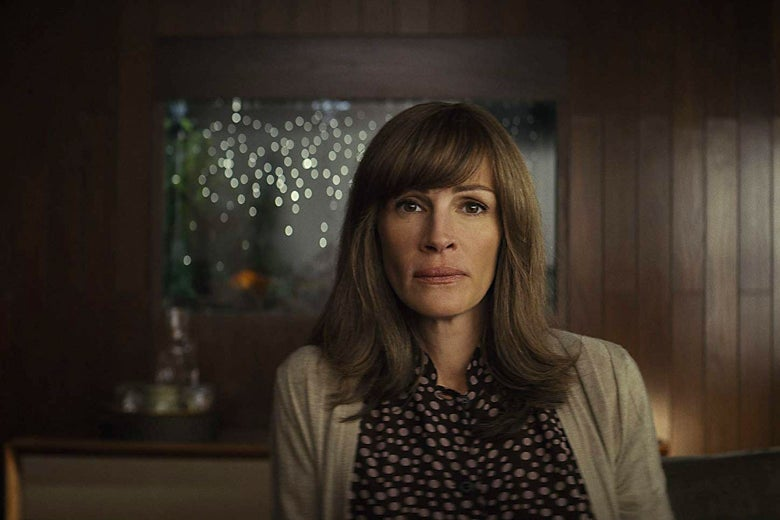 Julia Roberts not smiling, in a still from Homecoming.
