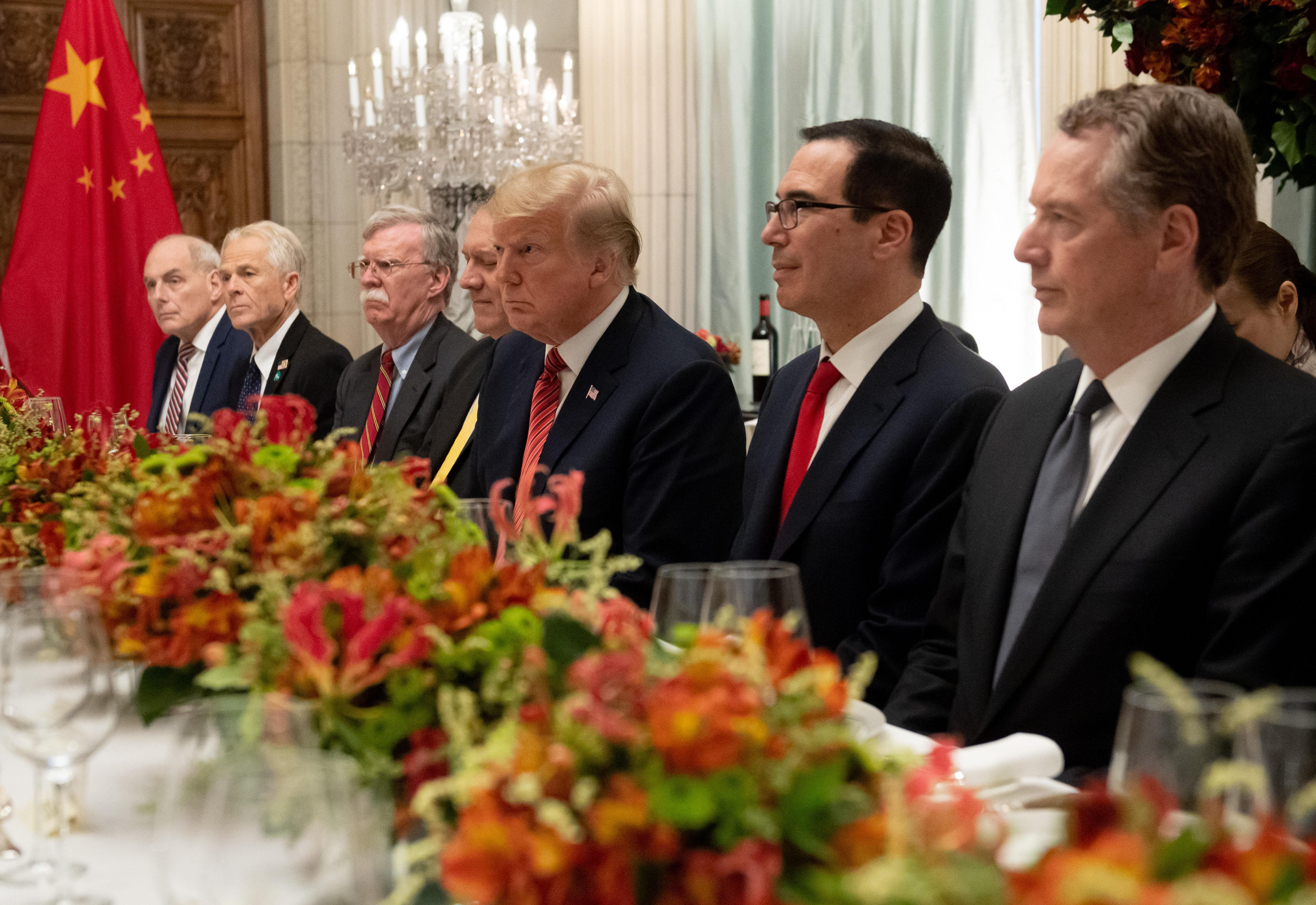 US President Donald Trump (C), US Secretary of the Treasury Steven Mnuchin (2-R), US Trade Representative Robert Lighthizer along with members of their delegation hold a dinner meeting with China's President Xi Jinping (out of frame) at the end of the G20 Leaders' Summit in Buenos Aires, on December 01, 2018. - US President Donald Trump and his Chinese counterpart Xi Jinping had the future of their trade dispute -- and broader rivalry between the world's two top economies -- on the menu at a high-stakes dinner Saturday. (Photo by SAUL LOEB / AFP)        (Photo credit should read SAUL LOEB/AFP/Getty Images)