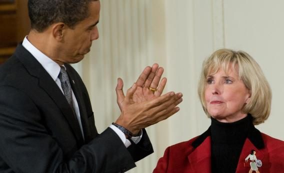 President Barack Obama applauds Lilly Ledbetter before signing the Lilly Ledbetter Fair Pay Act on Jan. 29, 2009