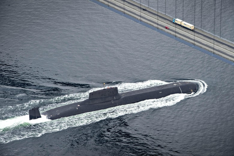 The Russian nuclear submarine Dmitrij Donskoj sails under the Great Belt Bridge between Jyutland and Fun through Danish waters, near Korsor, on July 21, 2017, on it's way to Saint Petersburg to participate in the 100th anniversary of the Russian Navy, held in on 29th - 30th July.  The submarine is 172 meters long and is thus the largest nuclear powered submarine in the world, and it's the first time it sails into the Baltic Sea.  / AFP PHOTO / Scanpix Denmark AND Scanpix / Michael BAGER / Denmark OUT        (Photo credit should read MICHAEL BAGER/AFP/Getty Images)