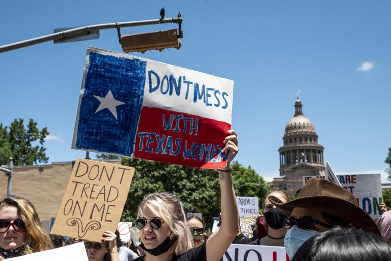 """Protesters in front of the Texas Capitol with signs that read """"Don't Mess With Texas Women."""""""