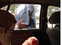 A burqa-clad beggar