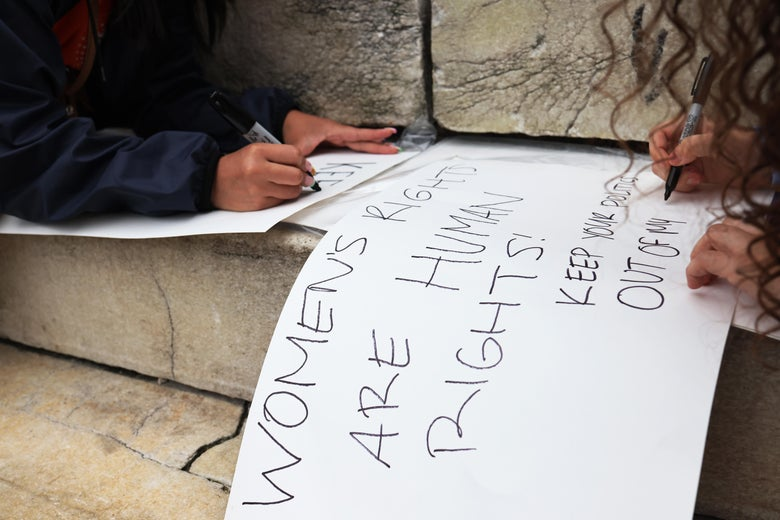 People are seen making signs on some steps.