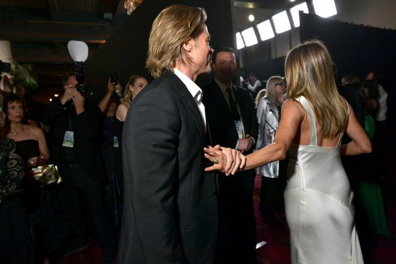 Jennifer Aniston turns away from Brad Pitt on the red carpet.