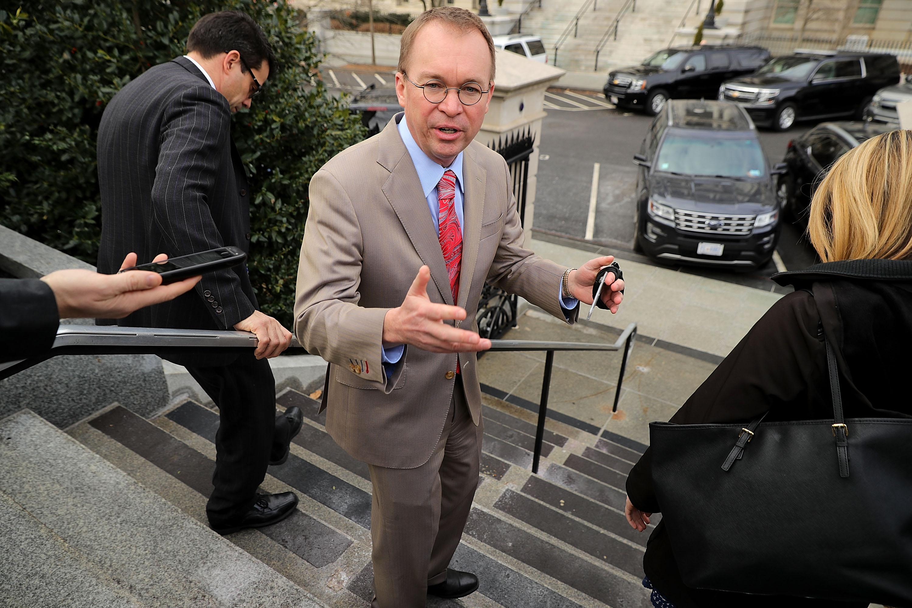 WASHINGTON, DC - JANUARY 22:  Office of Management and Budget Director Mick Mulvaney talks briefly to reporters about the ongoing partial federal government shutdown outside the White House January 22, 2018 in Washington, DC. Lawmakers and the White House continue to negotiate an end to the shutdown with a vote scheduled for noon in the U.S. Senate.  (Photo by Chip Somodevilla/Getty Images)
