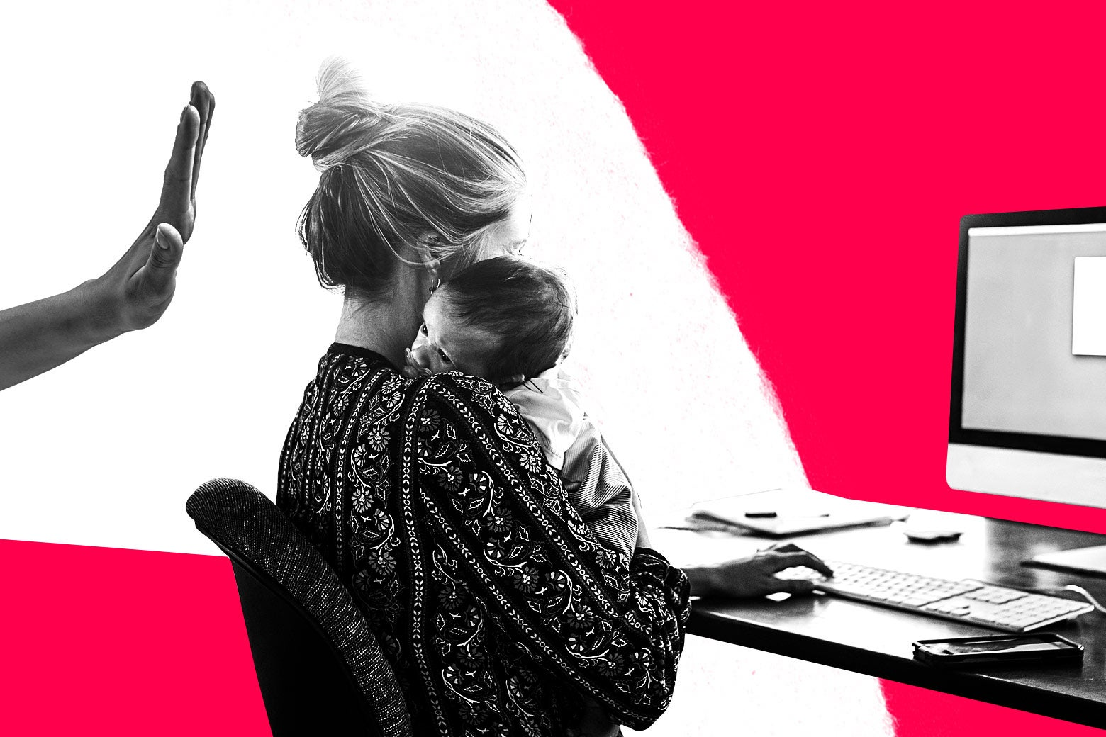 Woman sitting with a baby in front of a computer, a hand gesturing no.