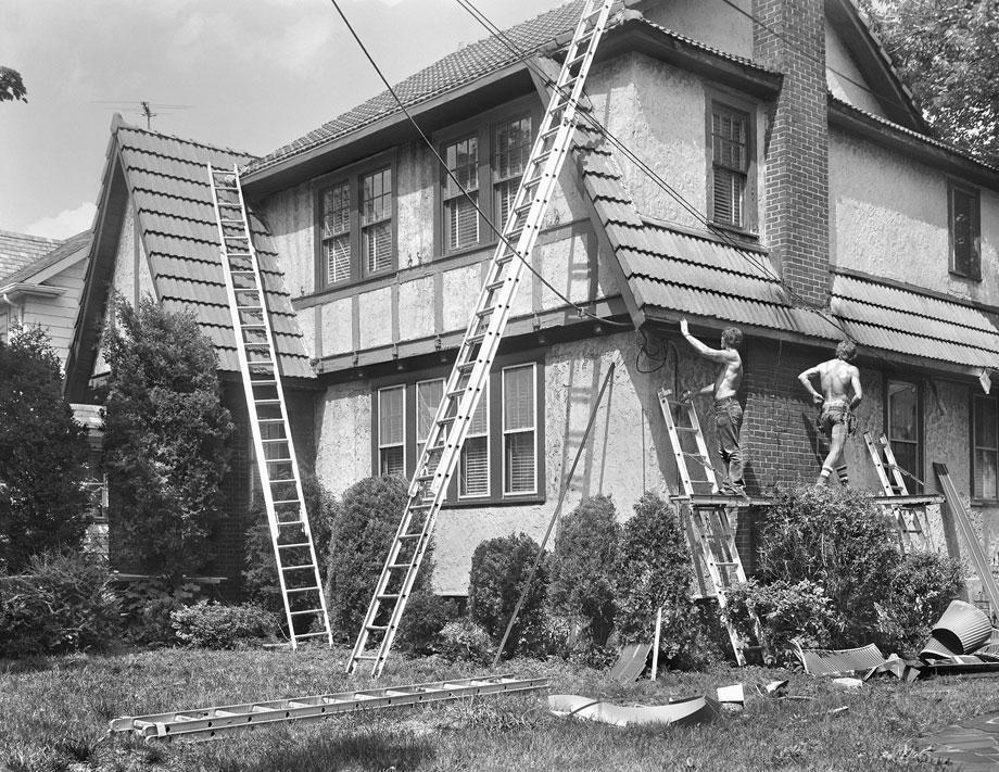 Two Men Repairing West Brighton House