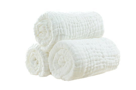 Three rolled up white towels.