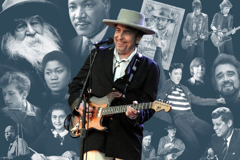 "Bob Dylan holds a guitar and stands in front of a collage of Jimmie Rodgers, Odetta, Carl Wilson of the Beach Boys, John F. Kennedy, Billy ""the Kid"" Emerson, a young Bob Dylan, Walt Whitman, Elvis Presley, Calliope, Martin Luther King Jr., Bill and Charlie Monroe, Anne Frank, an Indiana Jones poster, the Rolling Stones, and Wolfman Jack."