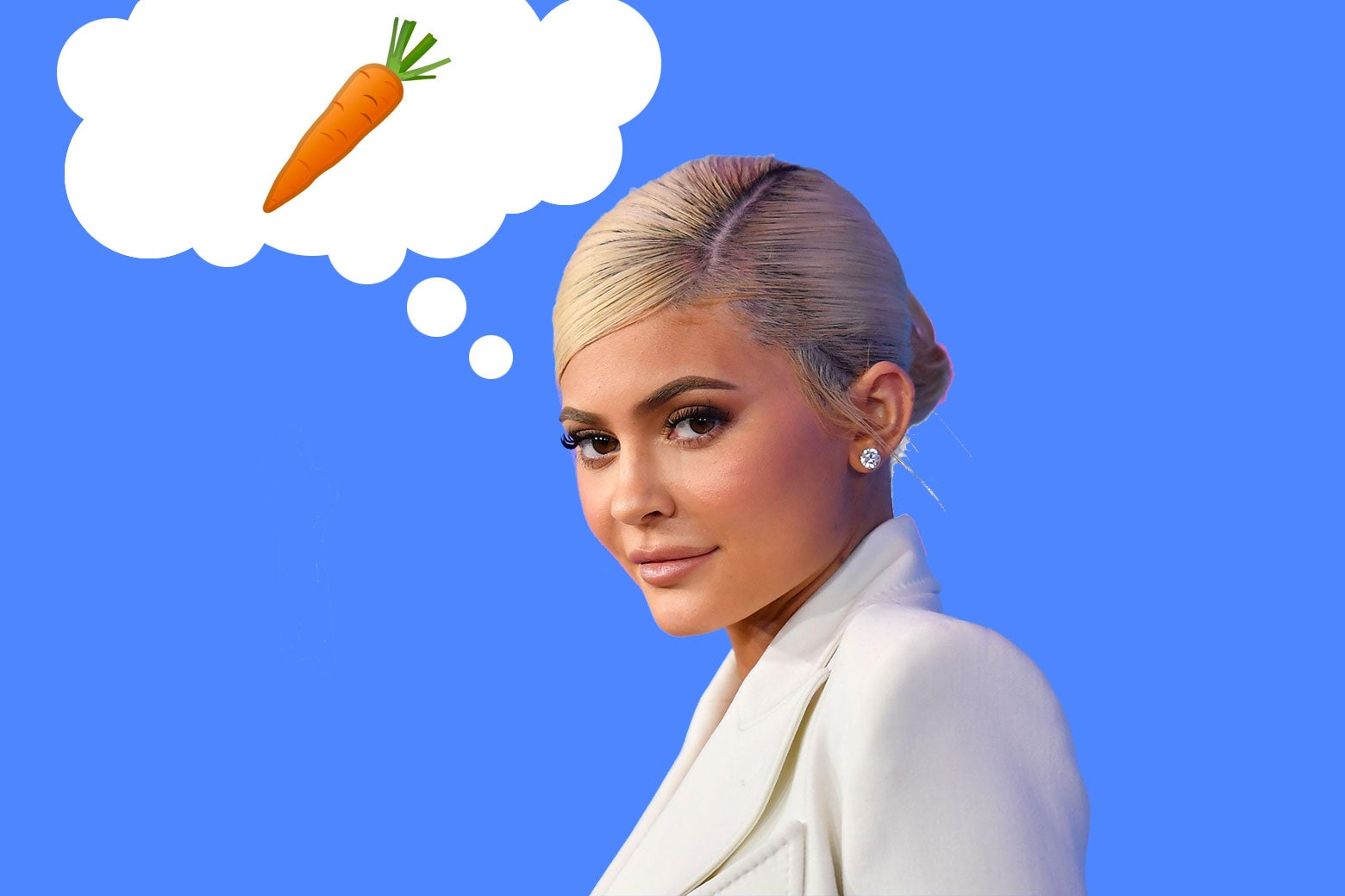 Kylie Jenner in front of a blue background thinking of a single carrot.