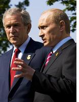 Vladimir Putin, right, and George Bush          Click image to expand.