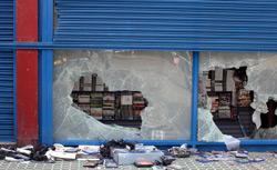 A general view of a computer games store in Brixton after looting on August 8, 2011 in London, England. Click image to expand.