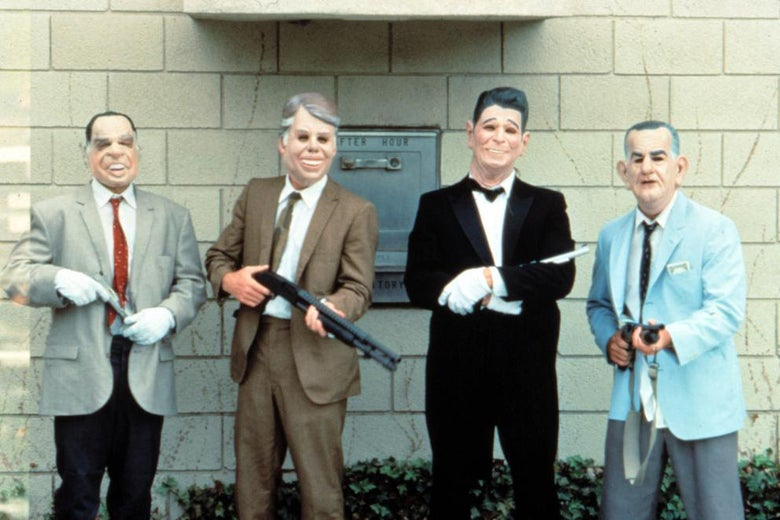 Four bank robbers from Point Break, wearing masks with the faces of presidents on them.