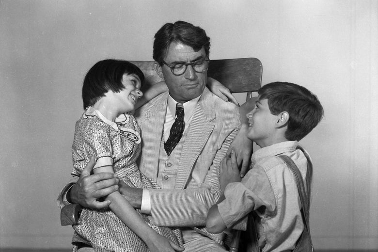 Atticus, Scout and Jem share a familial embrace in the 1962 To Kill a Mockingbird film.