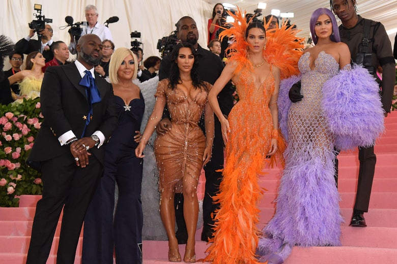 Corey Gamble, Kris Jenner, Kanye West, Kim Kardashian West, Kendall Jenner, Kylie Jenner, and Travis Scott on the stairs of the Met.