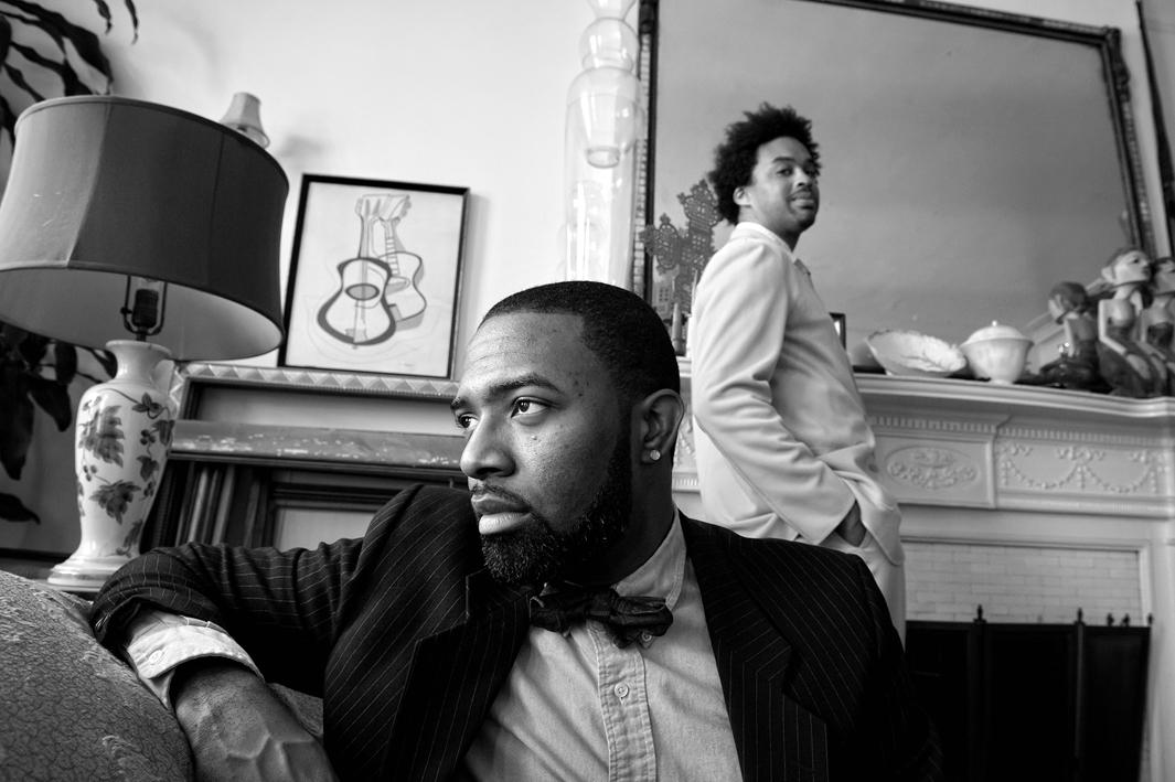 Harlem, New York 2011. Jerome Williams with his social father James Reynolds in the background. James is Jerome's main father figure, even though Jerome knows of his biological father.