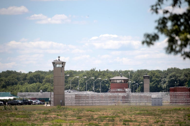 A guard tower sits along a security fence at the Federal Correctional Complex