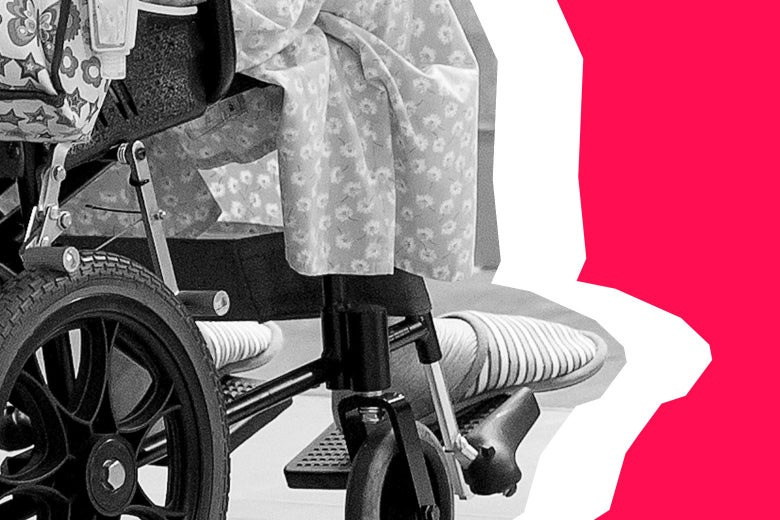 Lower side view of an elderly person using a wheelchair