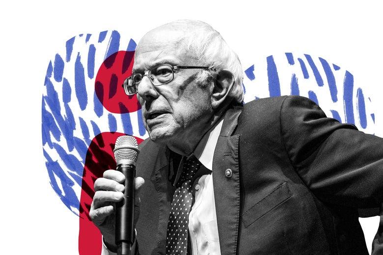 Bernie Sanders holds a microphone.