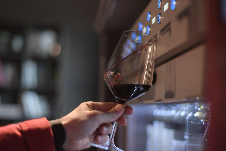 A man fills a glass of wine at the Sensory and Multimedia Wine Museum of Bolgheri and of Tuscanys Coast (MuSem) on October 3, 2017.