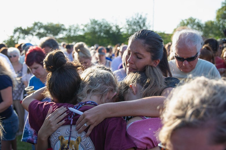 Friends and family attend a vigil held at the First Bank in Santa Fe for the victims of a shooting incident at Santa Fe High School where a shooter killed at least 10 students on May 18, 2018 in Santa Fe, Texas.