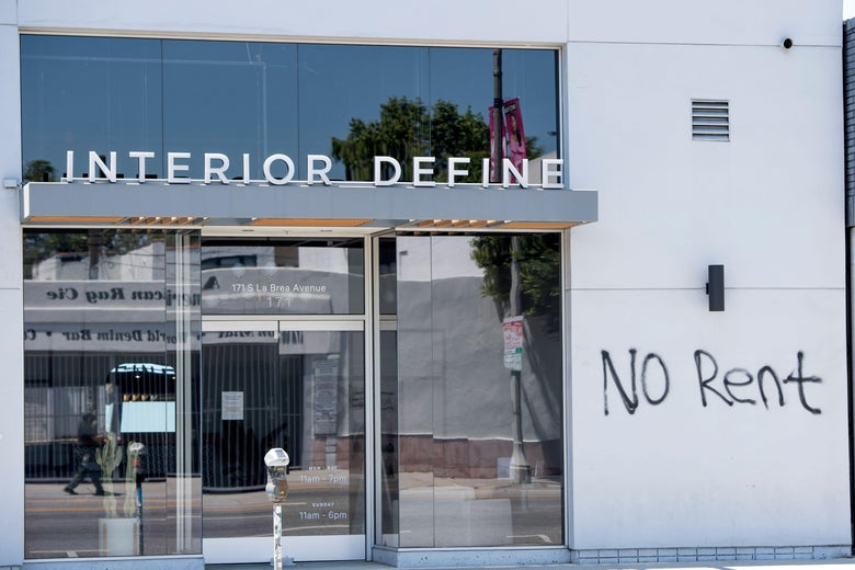 """A graffiti asking for """"No Rent"""" is seen on a wall of a building."""
