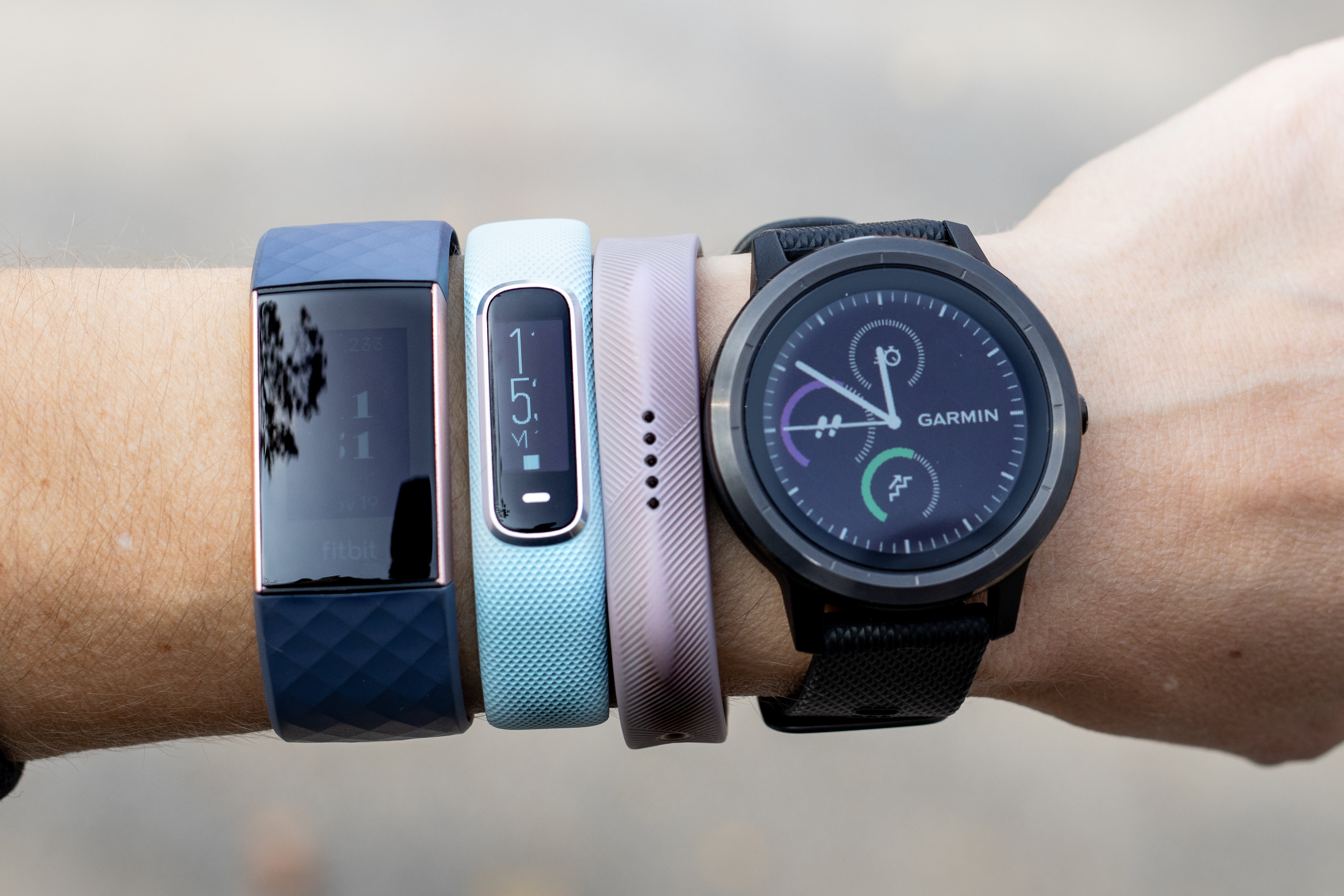 assorted fitness trackers on a wrist