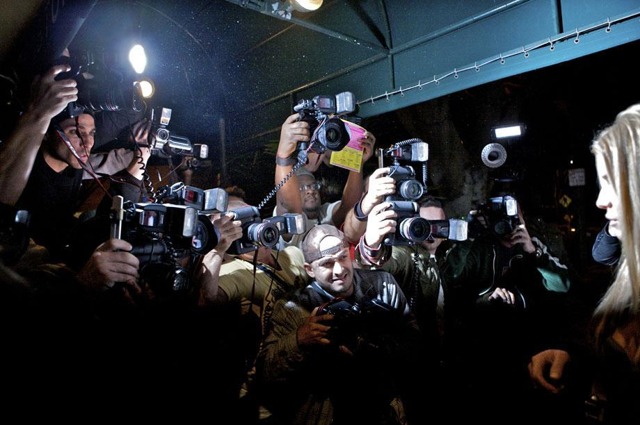 Paparazzi clamor for a shot of Jessica Simpson as she comes out of the restaurant Madeo in Los Angeles, Nov. 1, 2008.
