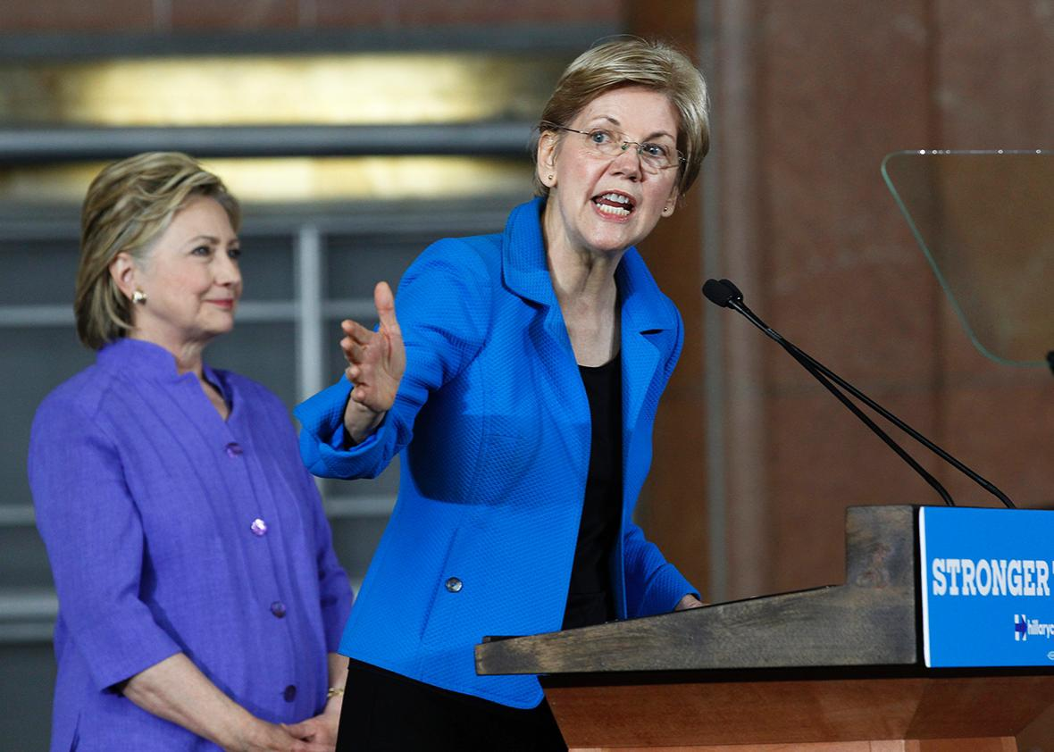 U.S. Sen Elizabeth Warren addresses the crowd as Democratic Presidential candidate Hillary Clinton looks on during a campaign rally at the Cincinnati Museum Center at Union Terminal June 27, 2016 in Cincinnati, Ohio.