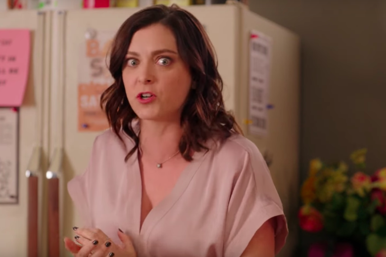 Rachel Bloom, as Rebecca Bunch, looks directly into the camera