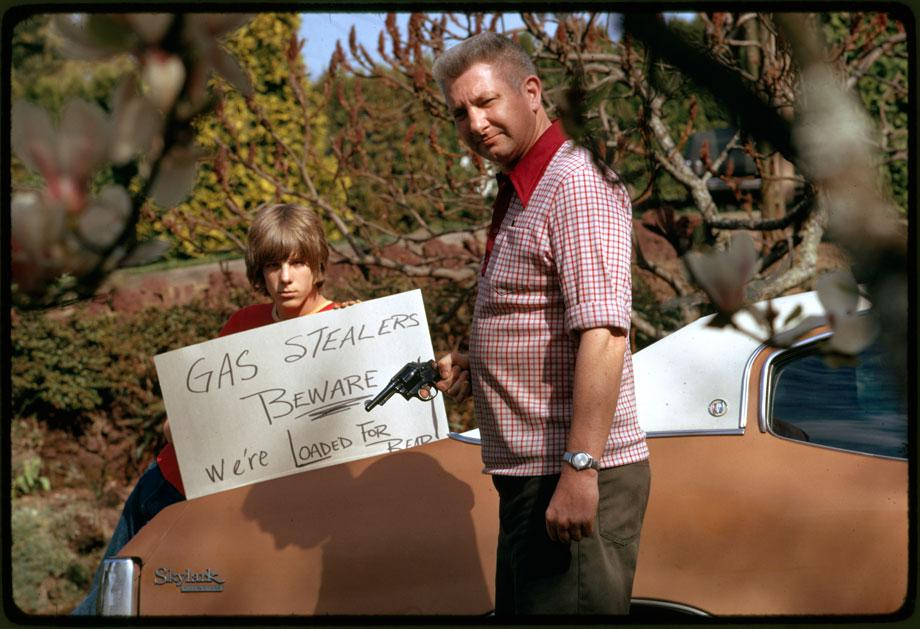 "Country's fuel shortage led to problems for motorists in finding gas as well as paying much more of it, and resulted in theft from cars left unprotected.  This father and son, made a sign warning thieves of the possible consequences"", April 1974Photographer: FalconerSeries: Photographs and other Graphic Materials from the Environmental Protection Agency, (12/09/1970-)Record Group 412: Records of the Environmental Protection Agency, 1944-2006ARC Series Identifier: 553111Still Pictures Identifier: 412-DA-10652Rediscovery Identifier: 25270"