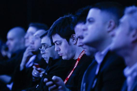 Audience members are tinted by stage lights while using their smartphones during Research in Motion's (RIM) launch of their Blackberry 10 devices in New York January, 2013.
