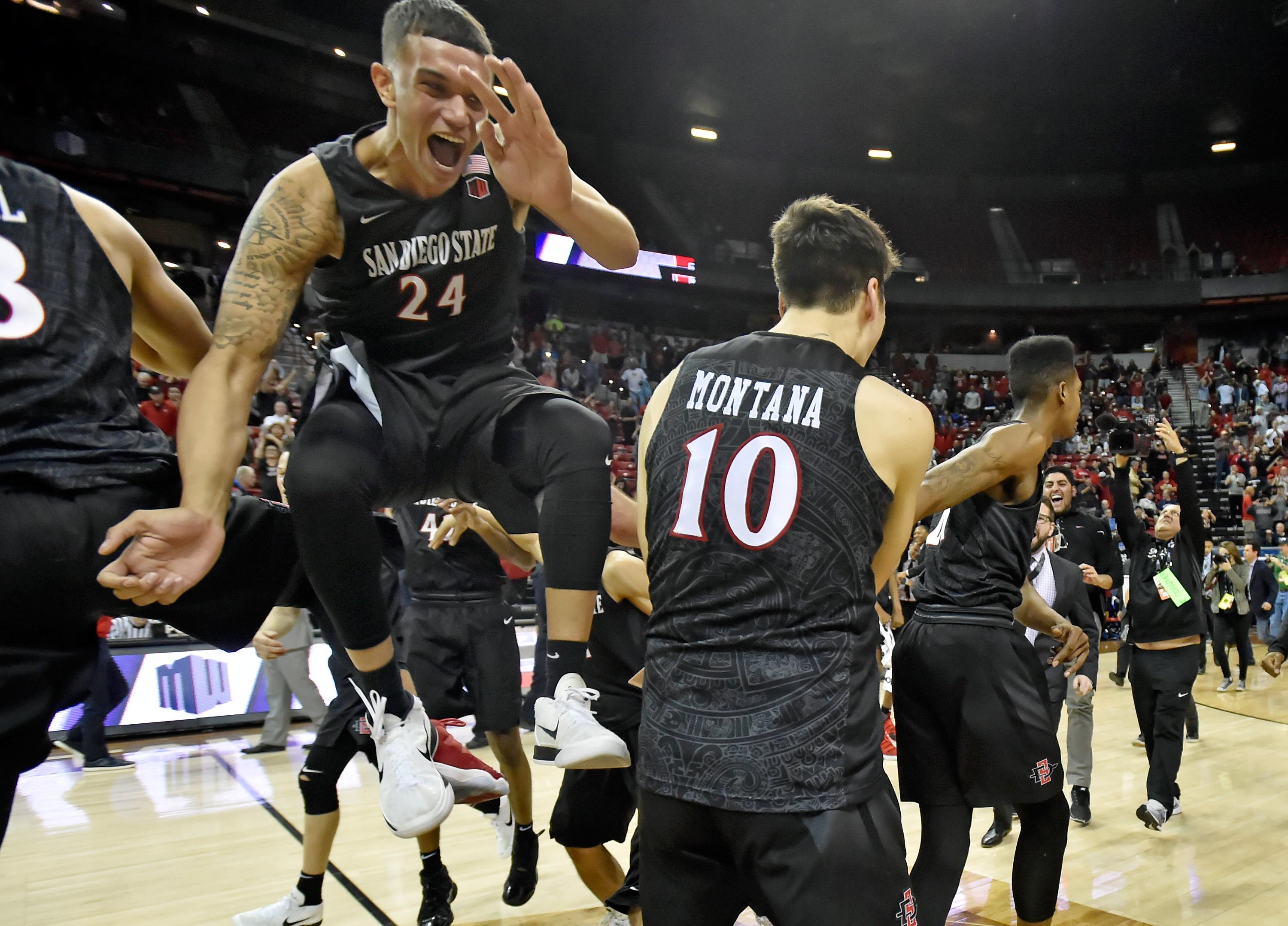 LAS VEGAS, NV - MARCH 10:  Nolan Narain #24 of the San Diego State Aztecs celebrates with teammates after the team defeated the New Mexico Lobos in the championship game of the Mountain West Conference basketball tournament at the Thomas & Mack Center on March 10, 2018 in Las Vegas, Nevada. San Diego State won 82-75.  (Photo by David Becker/Getty Images)