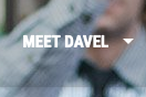"The text ""MEET DAVEL"" over a blurry photo of a man."
