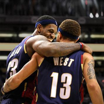 LeBron James celebrates with teammate Delonte West during an NBA game against the Phoenix Suns.