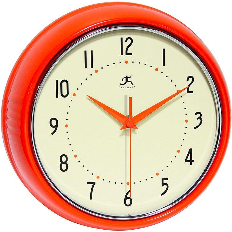 An orange wall clock.