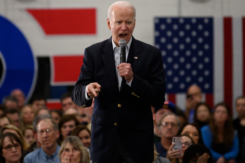 Joe Biden holding a mic and speaking to a crowd