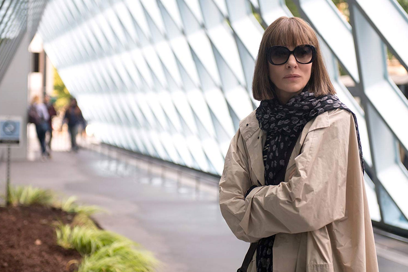 Cate Blanchett stands with her arms crossed in a hallway in this still from Where'd You Go Bernadette