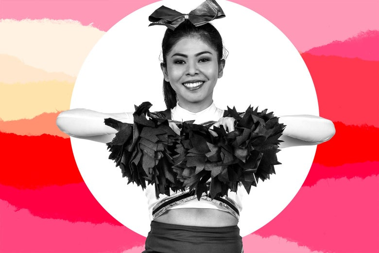 A girl wearing a cheerleading outfit, with pom-poms.
