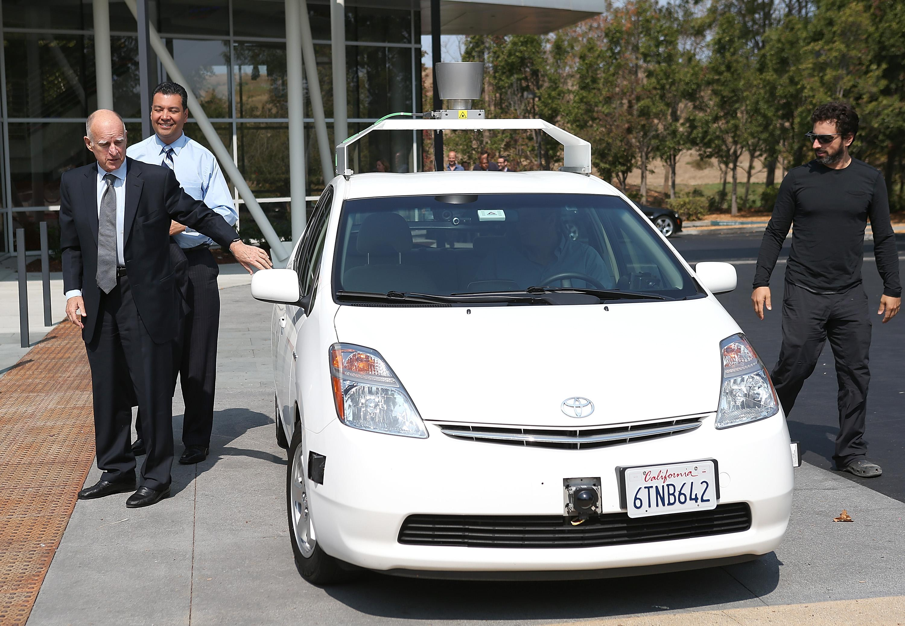 California Gov. Jerry Brown, California State Sen. Alex Padilla, and Google co-founder Sergey Brin exit a self-driving car at the Google headquarters on Sept. 25.