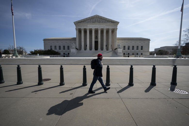 A man walks past the empty steps of the Supreme Court.