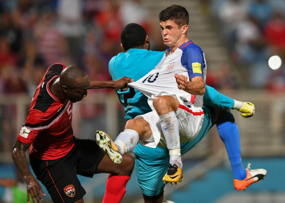 33e20ee5928 ... Cyrus and the United States  Christian Pulisic vie during their 2018  World Cup qualifier football match in Couva